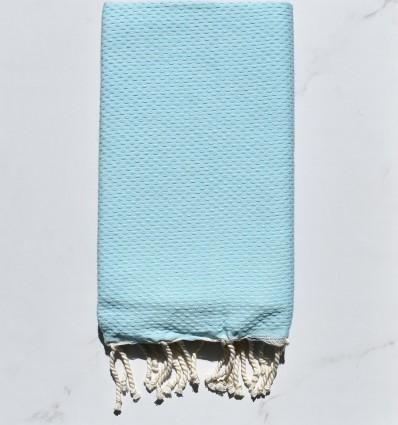 Strandtuch vereinigt blaues klares Wasser